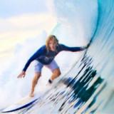 Surfing at Plage De L'Ermitage Beach
