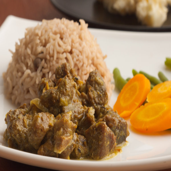 Curried Goat Served With Ofada Rice