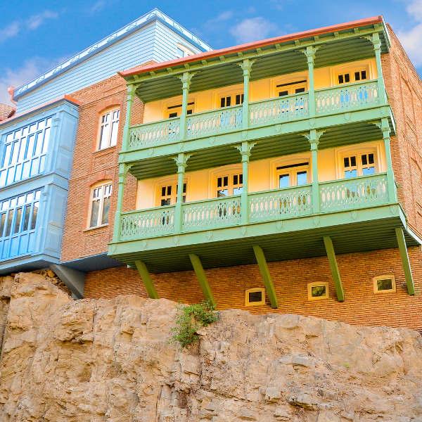 brick building green balcony