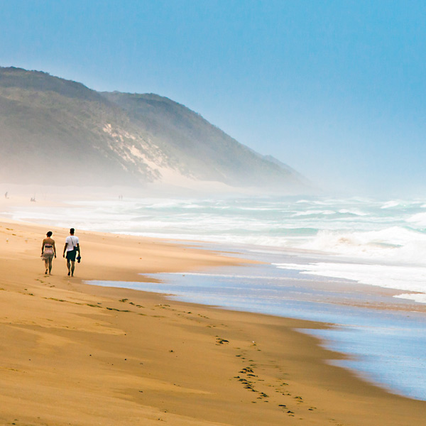 couple walking beach