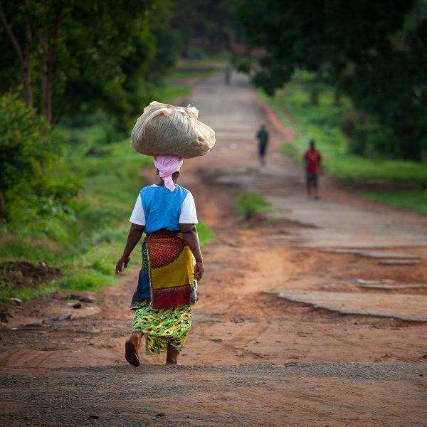 woman walking bag on head